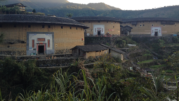 A cluster of three tulou buildings, deep in the hills of Fujian