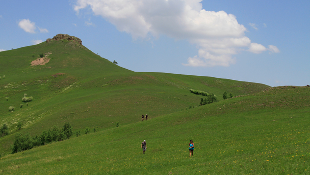Clouds over the green rolling hills of the Bashang Grasslands, Hebei Province