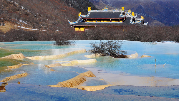 Huanglong Temple behind travertine terraces, Huanglong National Park, Sichuan, China