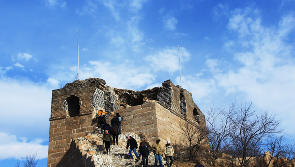 Hikers approach a ruined tower on the Longquanyu stretch of Great Wall