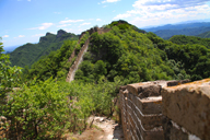 Hikers inch down a steep section of Great Wall