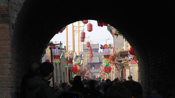 Looking through an arch in the thick walls of Nuanquanzhen