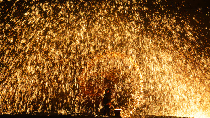 Showers of sparks during a performance of 'dashuhua'