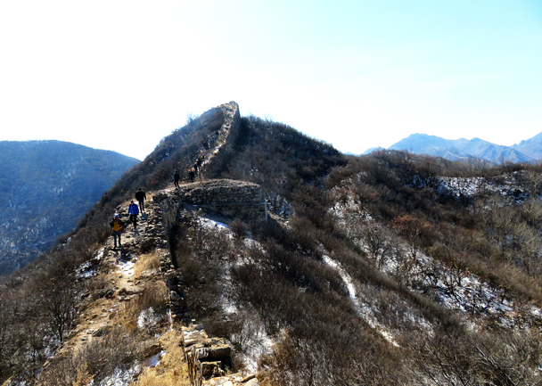 The hikers pass the base of an old tower - Zhenbiancheng Great Wall Loop, 2017/2/25