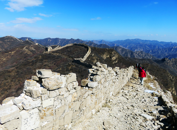 In the middle of the photo is an interesting feature – the line of wall curves up to stay on the highest ground, with a cutting running in front. We think they used the cutting as a source of stone for the wall, and it also makes it more difficult to attack - Zhenbiancheng Great Wall Loop, 2017/2/25