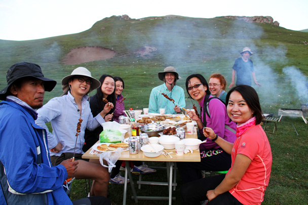 Enjoying dinner - Bayinbuluke Grasslands, Xinjiang, July 2016