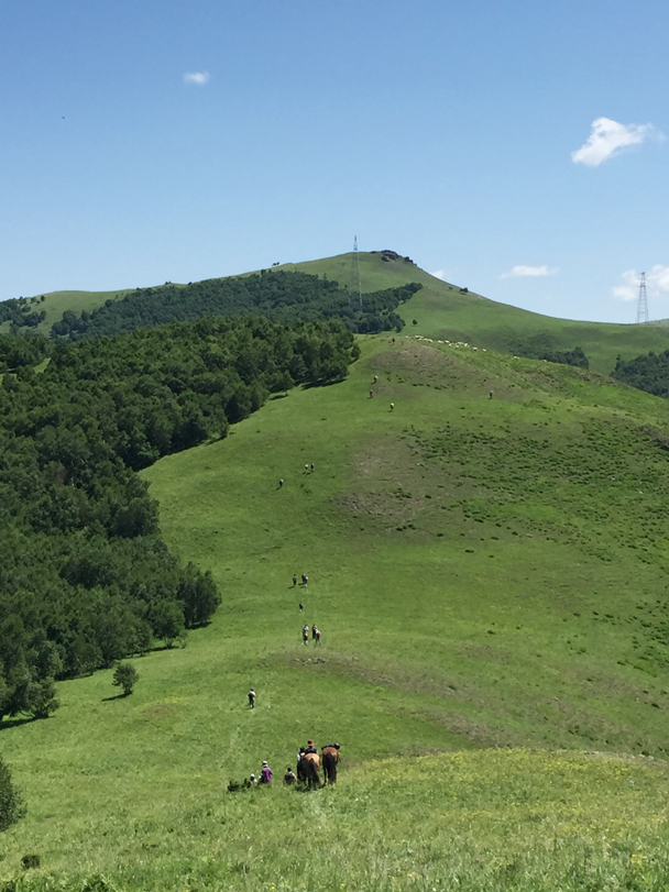 Hiking up the ridge, heading for a high point - Bashang Grasslands, August 2015