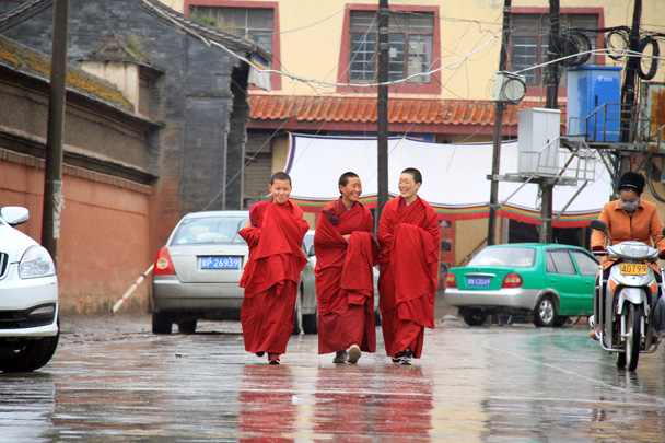 Three young monks walking down the street in Xiahe - Xiahe, Labrang Monastery, and Zhagana, Gansu Province, September 2015