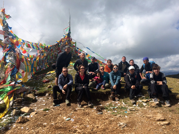 Group photo in front of the prayer flags - Xiahe, Labrang Monastery, and Zhagana, Gansu Province, September 2015