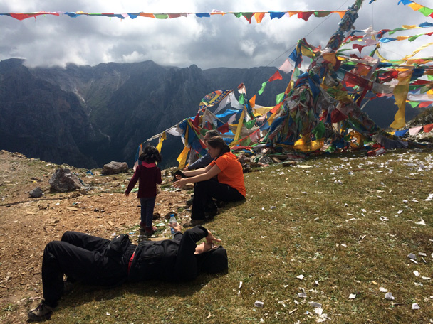 Taking a short break at the prayer flags - Xiahe, Labrang Monastery, and Zhagana, Gansu Province, September 2015