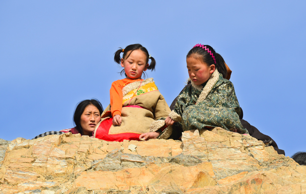 Kids perched on a rock (Photo by Dennis) - Labrang Monastery and Tibetan New Year, 2016/02