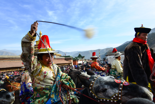 Riders at a temple (Photo by Dennis) - Labrang Monastery and Tibetan New Year, 2016/02