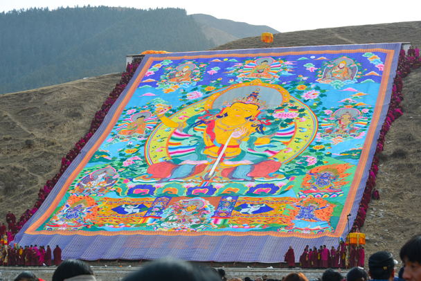 The embroidered thangka is unfurled on the hillside - Labrang Monastery and Tibetan New Year, 2016/02