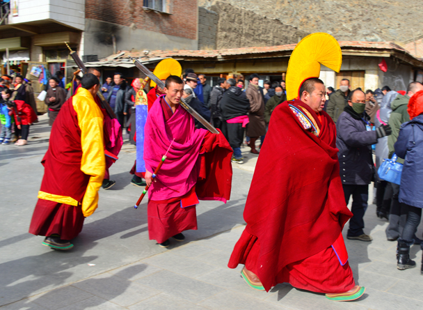 Monks walking through the crowd - Labrang Monastery and Tibetan New Year, 2016/02