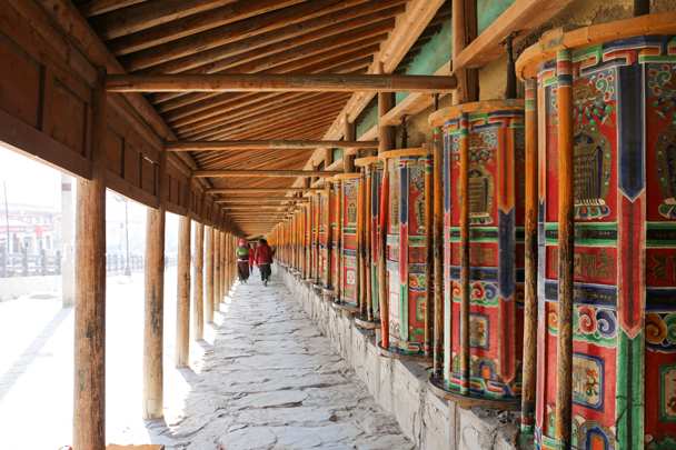 Prayer wheels surround a building - Labrang Monastery and Tibetan New Year, 2016/02