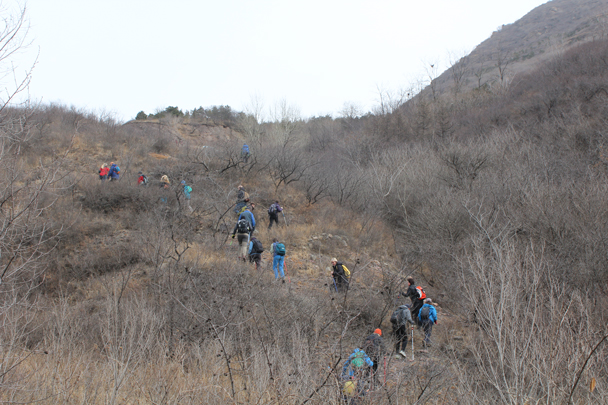 Behind the orchards we found the paved path up the hill -