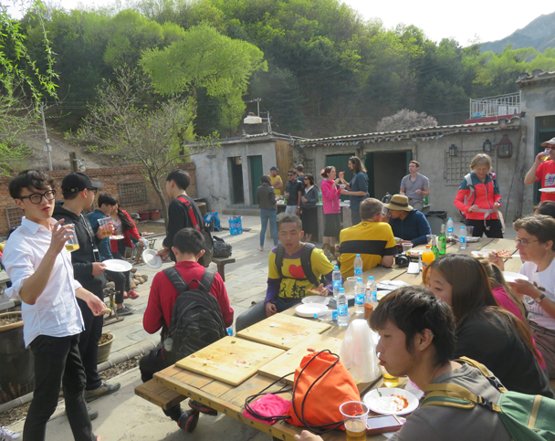 Gung Ho Pizza hosted us for a feast of pizza at their courtyard house in Jiankou Village - Great Wall clean up hike for Earth Day, 2016/4/23