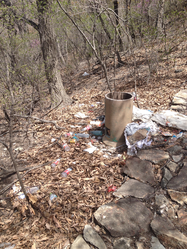 Before the park was closed, these rubbish bins might have been emptied occasionally. Not anymore, and now the rubbish just piles up beside them - Great Wall clean up hike for Earth Day, 2016/4/23