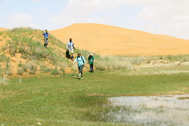 Hiking around a lake. It's a lot easier to hike on the grass - Tengger Desert, May 2016