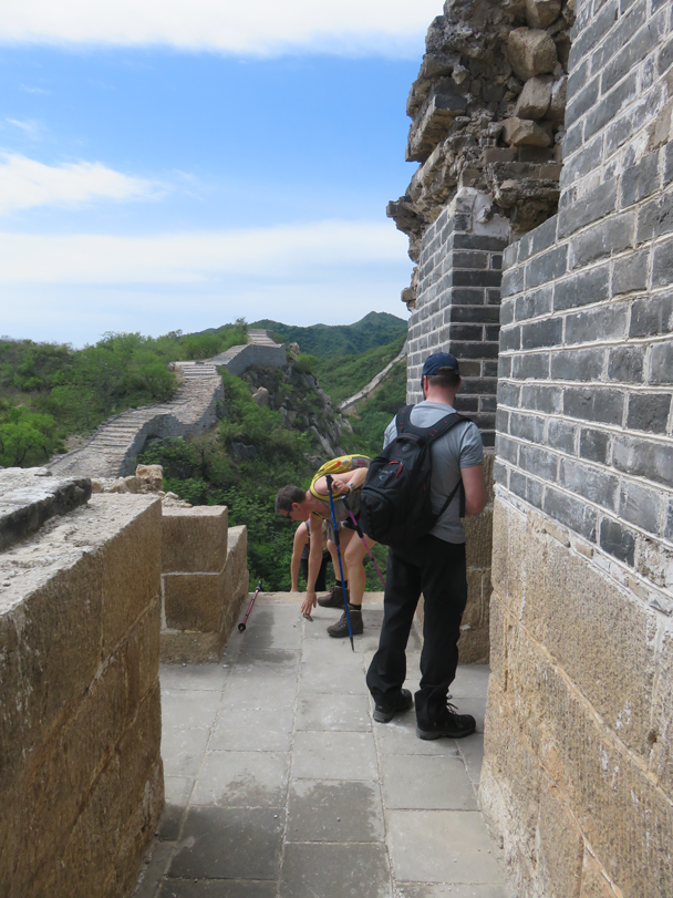Hikers are climbing up a large step into a guard tower - Longquanyu Great Wall to the Little West Lake, 2016/05/04