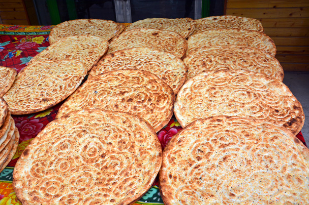 Super big naan bread (AKA 'hemek') in Kuqa - Along the Silk Road from Korla to Kashgar, June 2016
