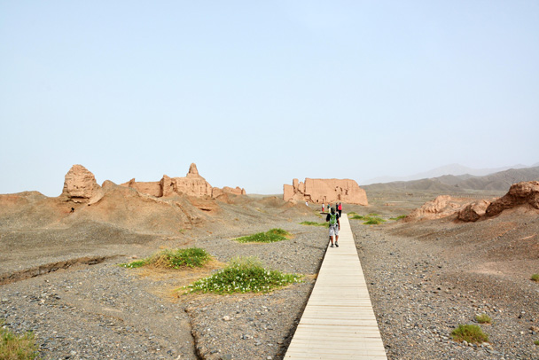 A wooden path leads towards to the remains of the temple at Subashi - Along the Silk Road from Korla to Kashgar, June 2016