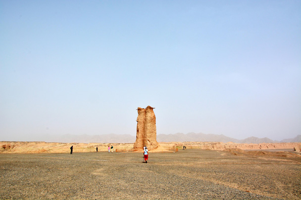 A Han Dynasty-era (206 BC-220 AD) tower stands almost 11 meters tall. It was made solely of mud and wood – well-built, to have lasted 2,000 years - Along the Silk Road from Korla to Kashgar, June 2016