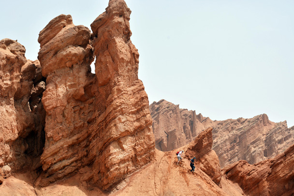 Yanjing and another tough hiker climbed up for a look at this crag - Along the Silk Road from Korla to Kashgar, June 2016