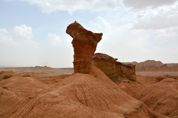 Mushroom-shaped pinnacle formed by the erosion of constant wind - Along the Silk Road from Korla to Kashgar, June 2016