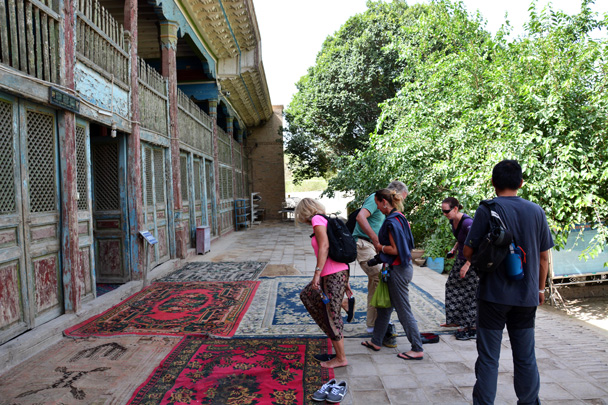 We are preparing to visit the prayer hall of the Grand Mosque in Kuqa. Taking off shoes is required before entry - Along the Silk Road from Korla to Kashgar, June 2016