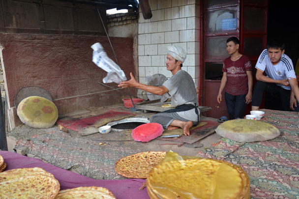 The baker is showing off his skills - Along the Silk Road from Korla to Kashgar, June 2016