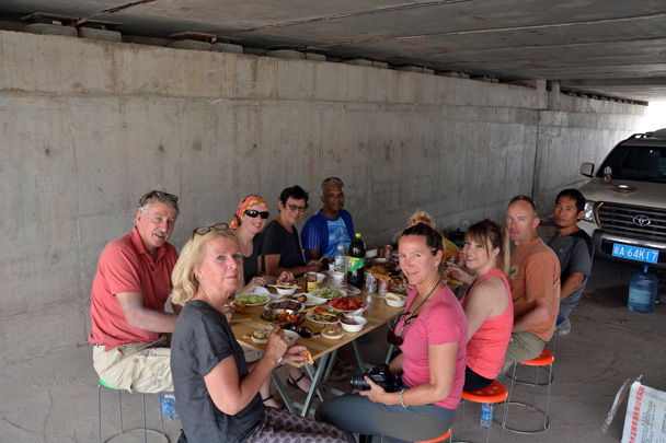 "Having our fancy lunch in the ""fancy restaurant"" – a shady spot under the highway on the way to Kashgar - Along the Silk Road from Korla to Kashgar, June 2016"