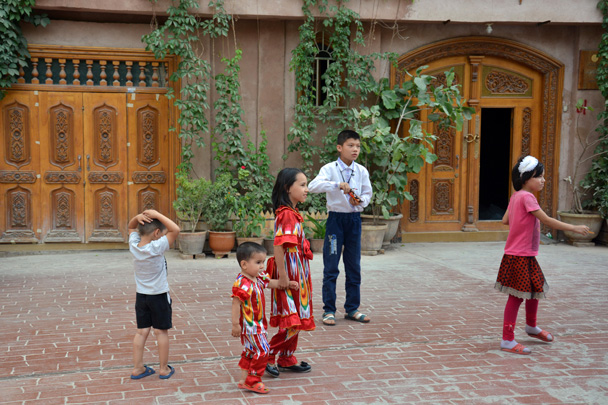 Kids are playing in front of their houses in the old city area of Kashgar - Along the Silk Road from Korla to Kashgar, June 2016