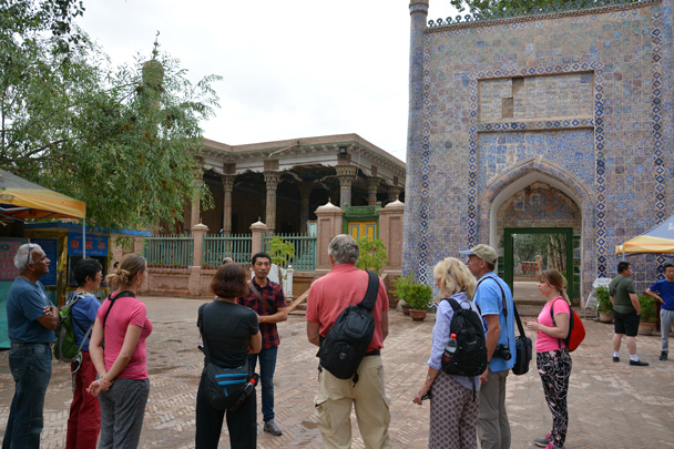 Our local expert in Kashgar is giving information about the Tomb of Xiangfei - Along the Silk Road from Korla to Kashgar, June 2016
