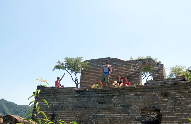 Hikers taking a break on a tower - Great Wall Spur hike, 2016/07/13