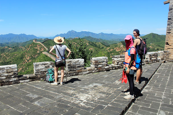Stopping to enjoy the view at a lookout point. Hiking guide Yolanda is well protected from the sun - Hemp Village to Jinshanling Great Wall East, 2016/08/14
