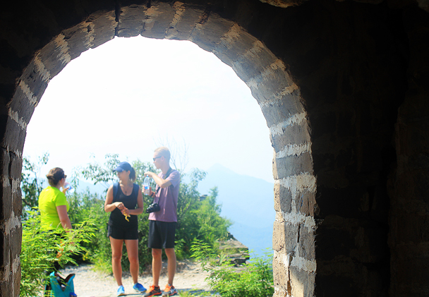 We stopped for a snack break, choosing shade inside the tower or sun outside - Walled Village to Huanghuacheng Great Wall, 2016/08/24