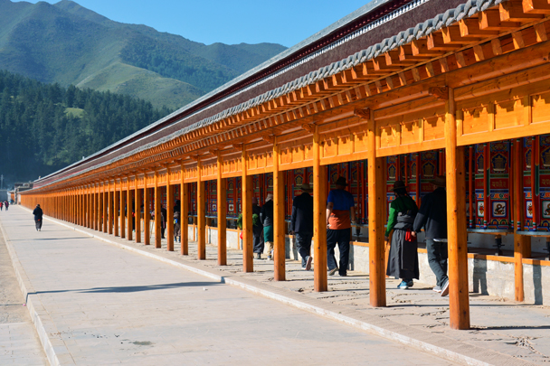 Prayer wheels in a long row - Xiahe, Labrang Monastery, and the Zhagana area in southern Gansu, September 2016
