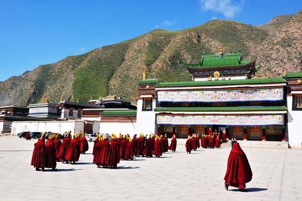 Monks heading in to the prayer hall - Xiahe, Labrang Monastery, and the Zhagana area in southern Gansu, September 2016