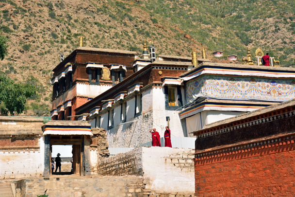The monk up on the roof was blowing on a big trumpet - Xiahe, Labrang Monastery, and the Zhagana area in southern Gansu, September 2016