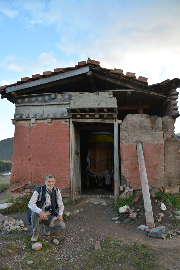 Reinhard in front of a shed that has a big prayer wheel hidden inside - Xiahe, Labrang Monastery, and the Zhagana area in southern Gansu, September 2016