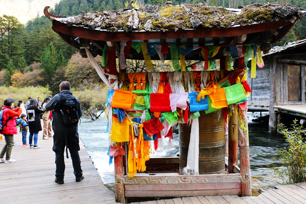 Flags adorn a prayer wheel - Jiuzhaigou and Huanglong National Parks, Sichuan, 2016/11
