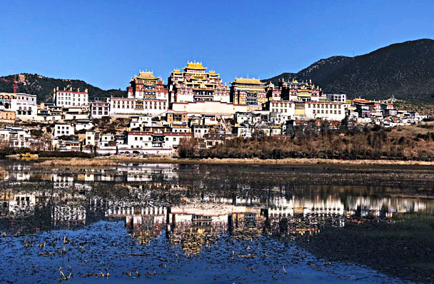 Songzanlin Monastery and its reflection in the lake - Lijiang and Shangri-La, Yunnan Province, November 2016