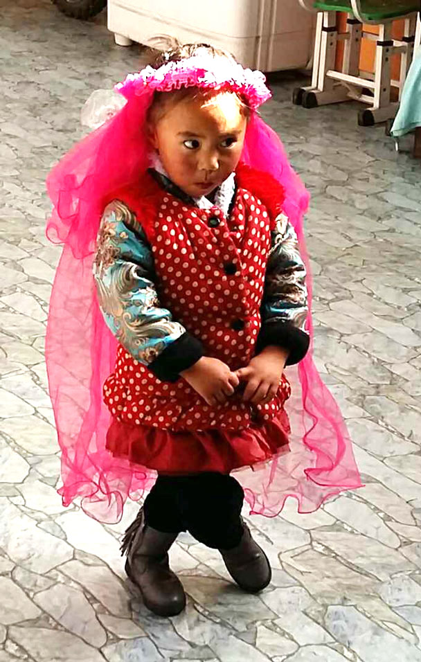 A cute little Tibetan girl - Lijiang and Shangri-La, Yunnan Province, November 2016