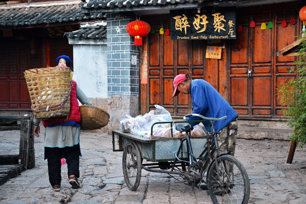 A morning scene in Lijiang, with people taking goods to the local market - Lijiang and Shangri-La, Yunnan Province, November 2016