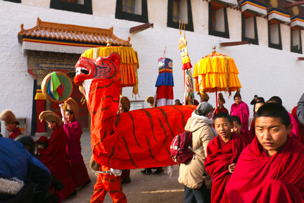 The 'Unveiling the Buddha' ceremony begins with a procession, led by the tiger - Labrang Monastery and Xiahe, Gansu