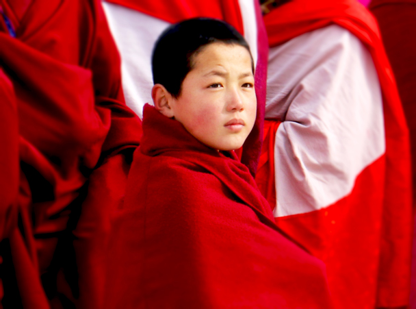 A young monk in the procession - Labrang Monastery and Xiahe, Gansu