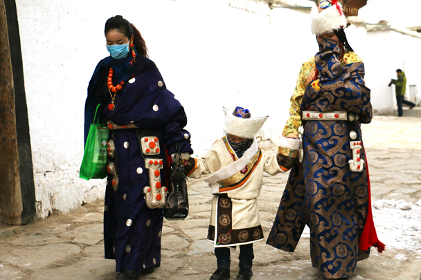 These women are wearing traditional Amdo clothing - Labrang Monastery and Xiahe, Gansu