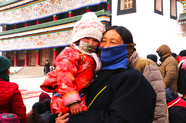 A little girl and her grandmother came to say hello to us - Labrang Monastery and Xiahe, Gansu