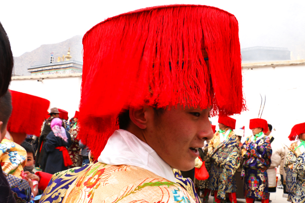 The people wearing this costume were part of a group that protects the Buddha - Labrang Monastery and Xiahe, Gansu